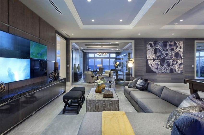 Contemporary living room with porcelain tile walls and gray sectional couch