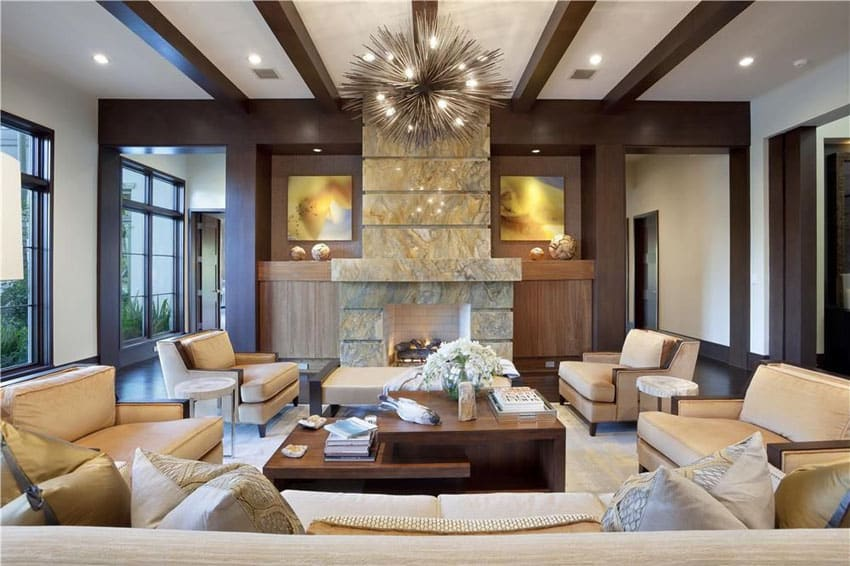 Contemporary living room with tan furniture and modern pointed chandelier