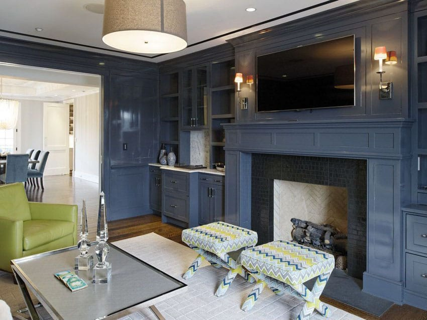 Contemporary living room with wainscoting and painted blue fireplace