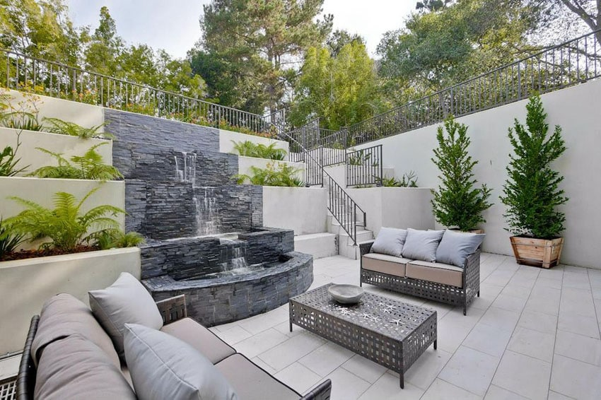 Contemporary luxury patio with stacked stone water fountain and outdoor furniture