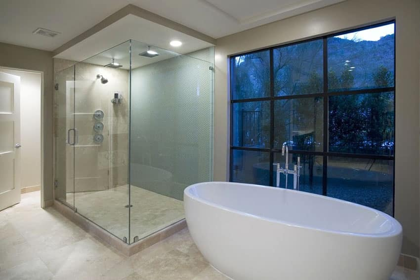 Contemporary master bathroom with rain shower with mountain views and marble slab tile