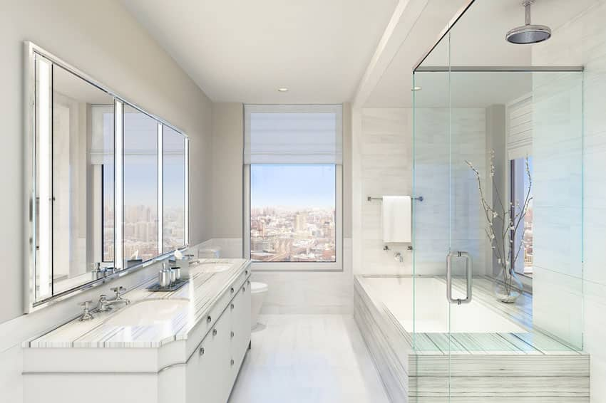 Contemporary master bathroom with rainfall shower and city views