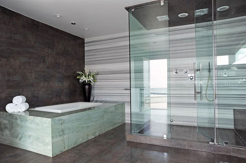 Contemporary master bathroom with soapstone bathtub enclosure and porcelain walls