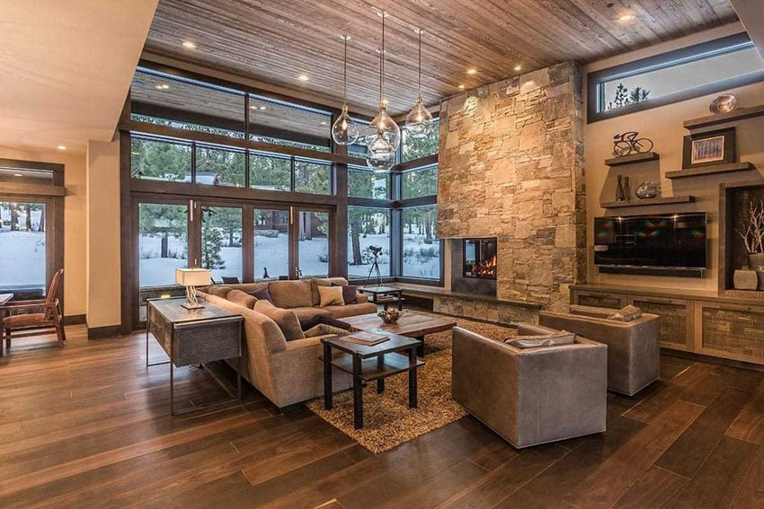 Contemporary stone and wood living room with fireplace and beautiful views of the outdoors