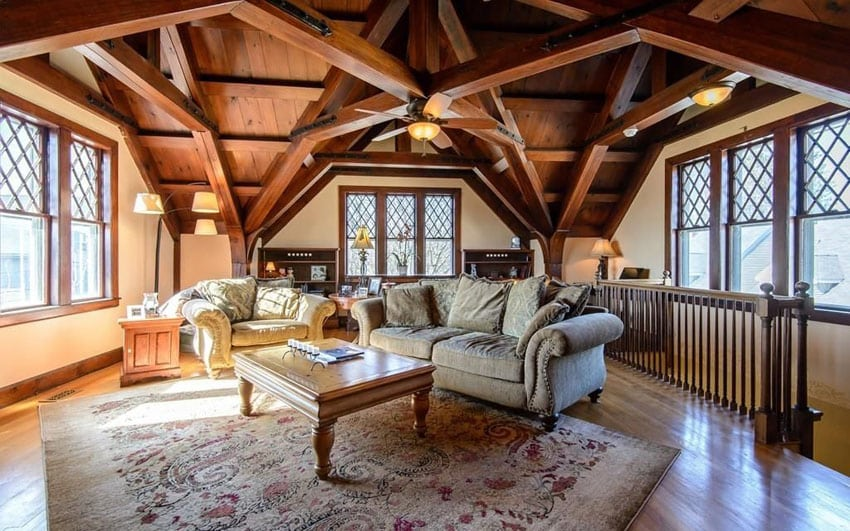 Craftsman living room with detailed open beam cathedral ceiling, wood lattice framed windows and wood flooring