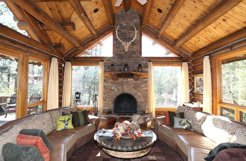 Craftsman living room with large picture windows and stone fireplace