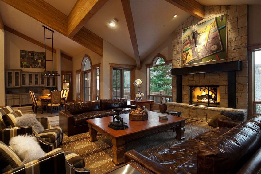 Craftsman living room with leather furniture and cathedral ceiling