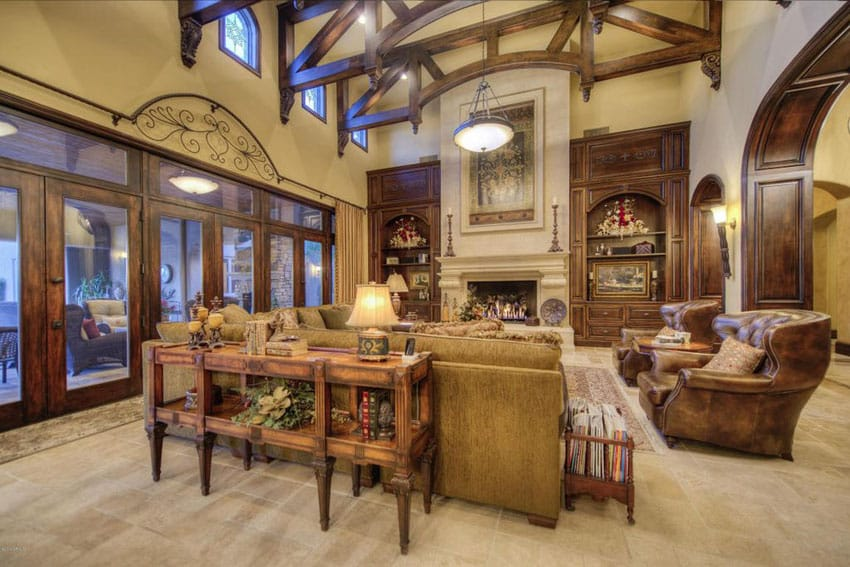 Craftsman living room with luxury furnishings and high vaulted ceiling with wood beams