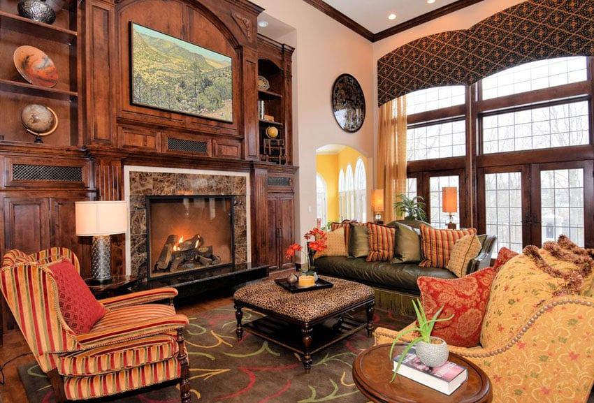 Craftsman room with detailed woodwork molding and fireplace