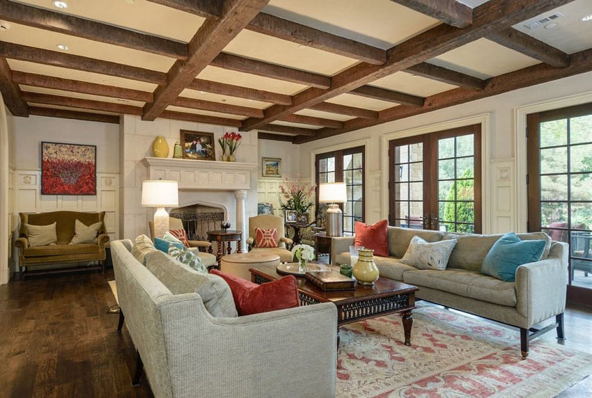 Craftsman style living room with rough exposed beams and hardwood floors