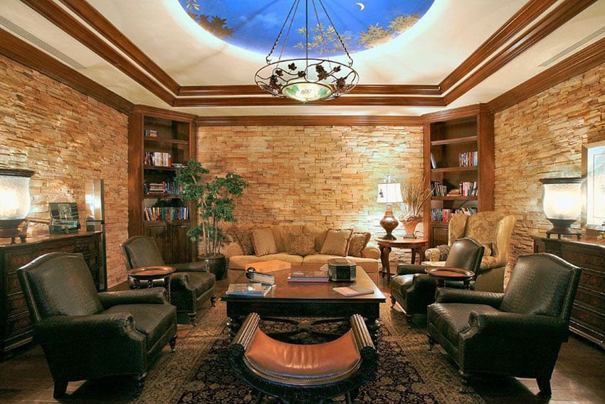 Craftsman style living room with stacked stone walls and blue and gold ceiling mural