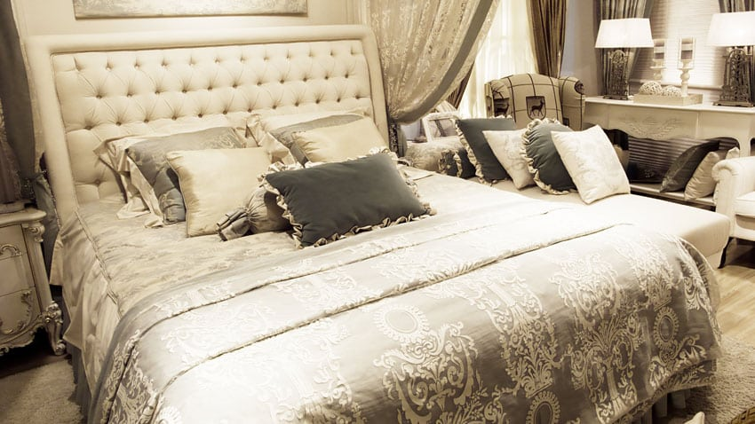 Cream color bedroom set with matching furniture and linens