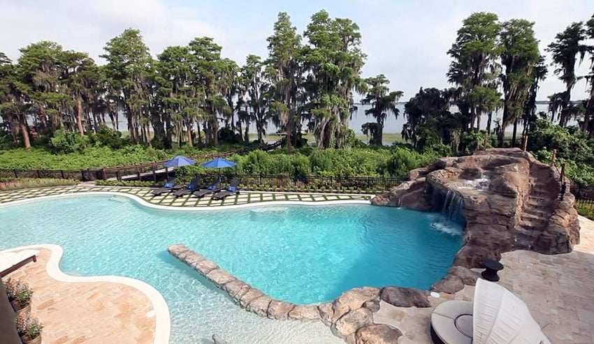 Custom beach lagoon style pool with water feature slide