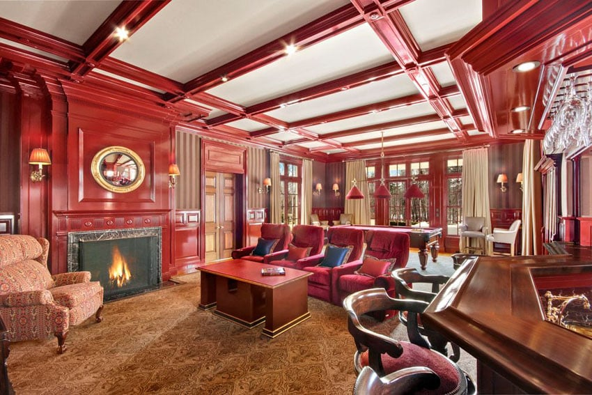 Custom cherry wood living room with decorative woodwork and home bar