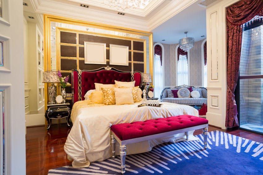 Luxury bedroom with bright color decor, bed bench, sitting area and tray ceiling