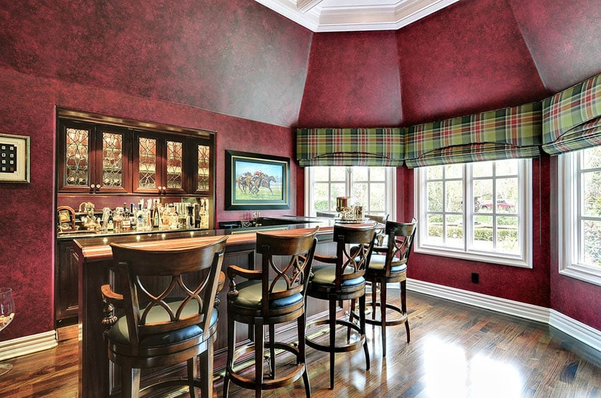 Custom home bar with window views and hardwood floors