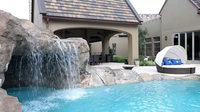 Custom pool with swimming grotto and waterfall