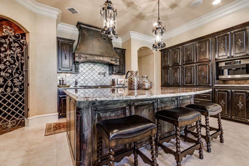 Dark cabinet Mediterranean style kitchen with granite island breakfast bar