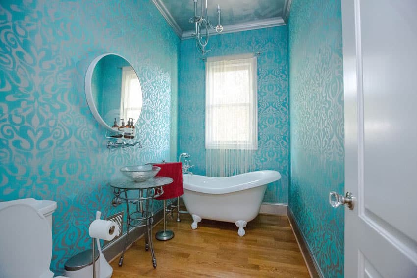 Eclectic bathroom with acrylic clawfoot tub with imperial feet