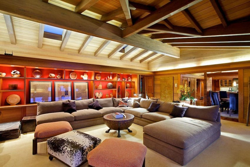 Eclectic living room design with bright red accent wall