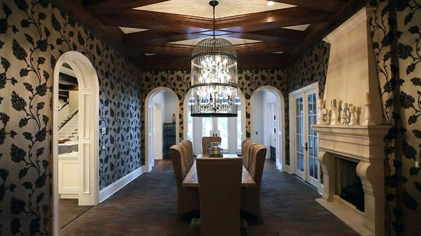 Elegant gold and black dining room with patterned wallpaper