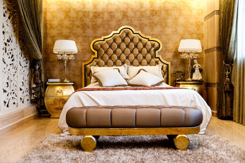 Elegant gold theme bedroom with plush headboard