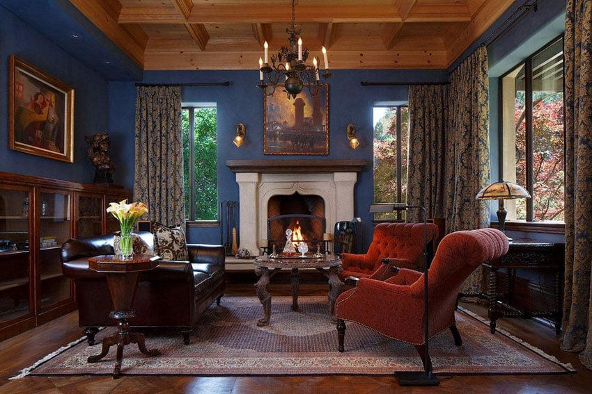 Elegant living room with fireplace and blue walls with wood ceiling