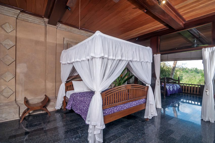 Exotic bedroom design with open air layout with balcony and canopy bed