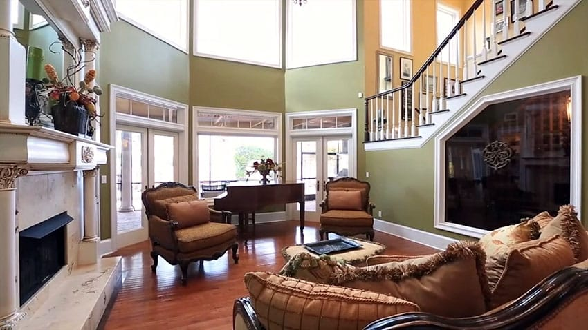 Formal living room with hardwood floors and brown grand piano