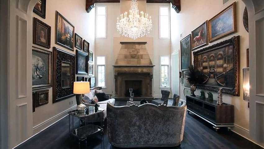 Formal living room with high ceiling chandelier and artwork