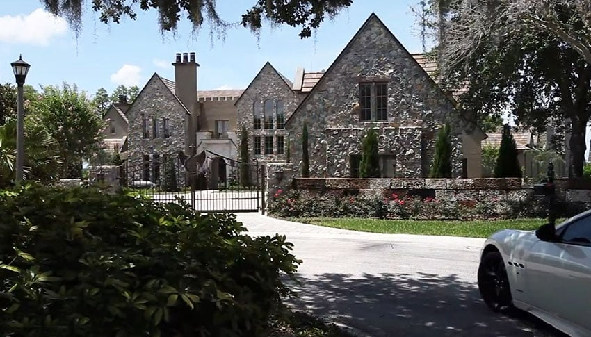Front driveway of custom modern castle style home