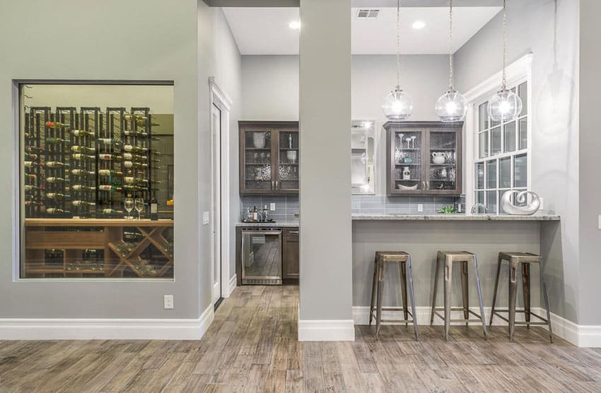 Home wet bar with access to wine cellar