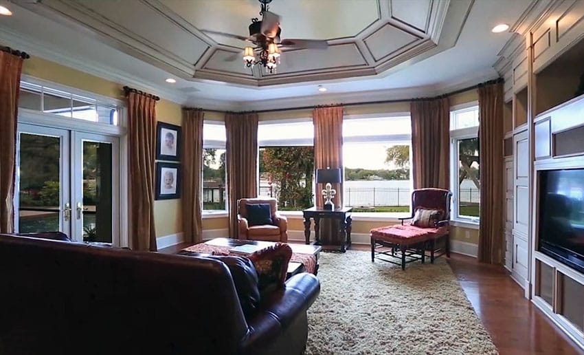 Lake front living room with tray ceiling