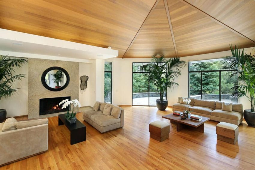 Large living room with hardwood floors wood ceiling and fireplace
