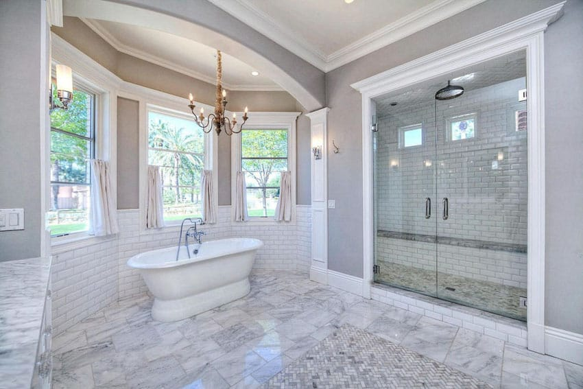 Large luxury bathroom with white subway tile and black accent shower
