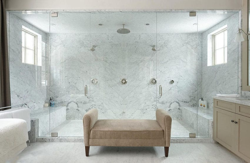 Large luxury shower with bianco gioia marble