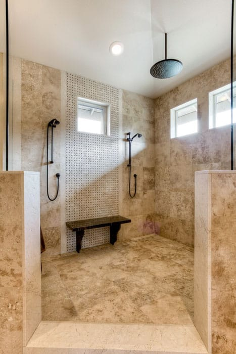 Large luxury shower with rainfall showerhead glazed porcelain tile and mosaic tile accent wall