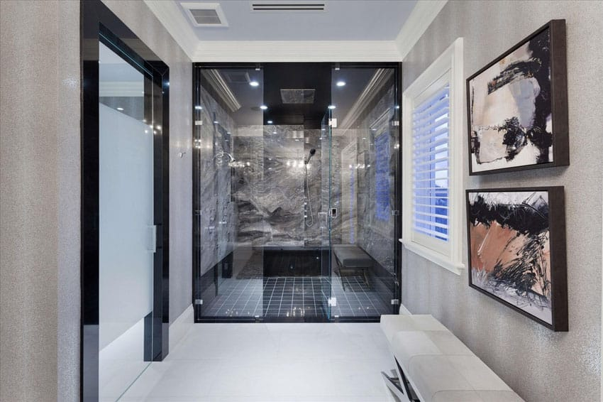 Large shower with gray marble and black tile