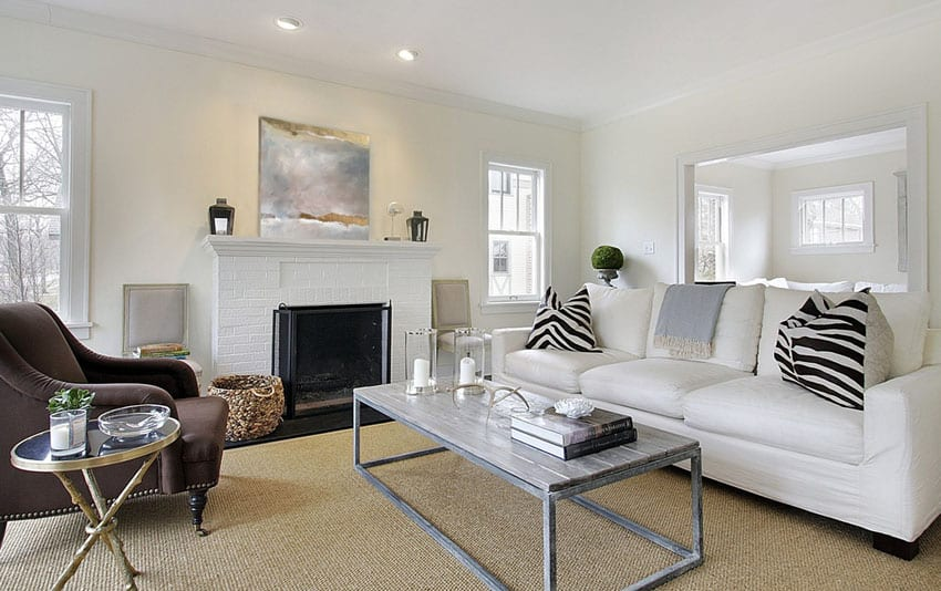 Living room with white sofa and white painted brick fireplace