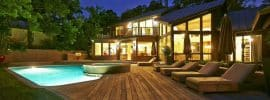 luxury-backyard-with-wood-deck-next-to-swimming-pool