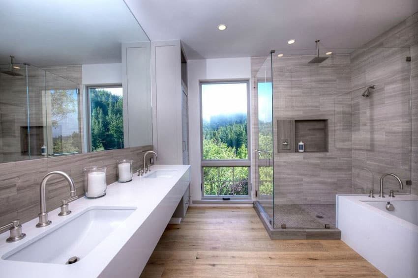 Luxury bathroom with shower with window views and porcelain tile