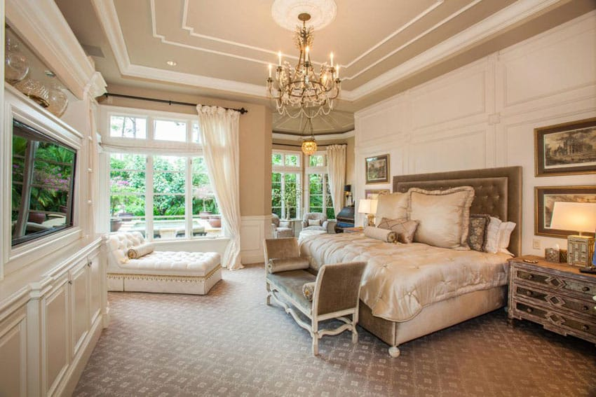 Luxury bedroom with elegant decor and tufted chaise lounge