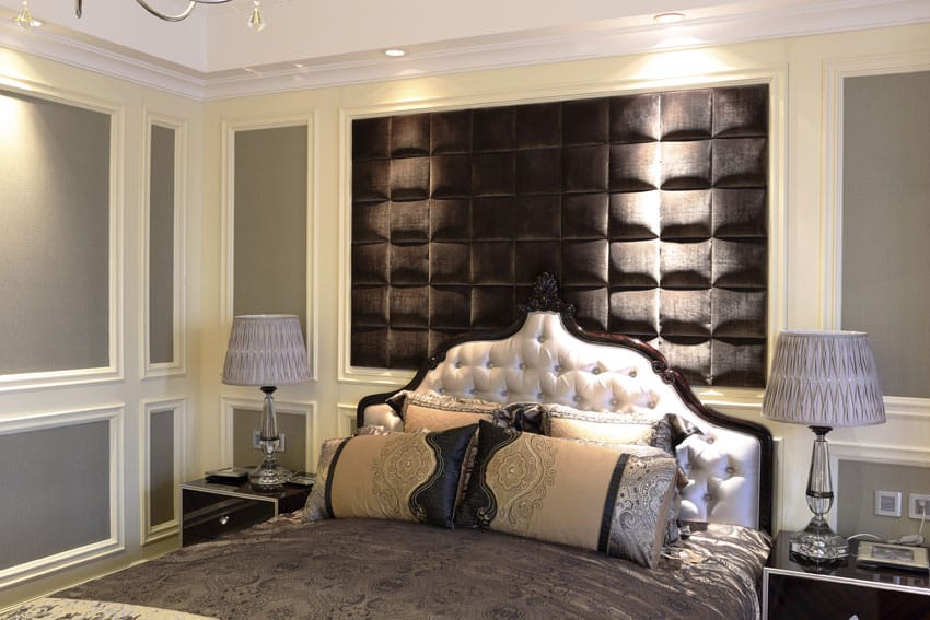Luxury bedroom with white molding and accent wall