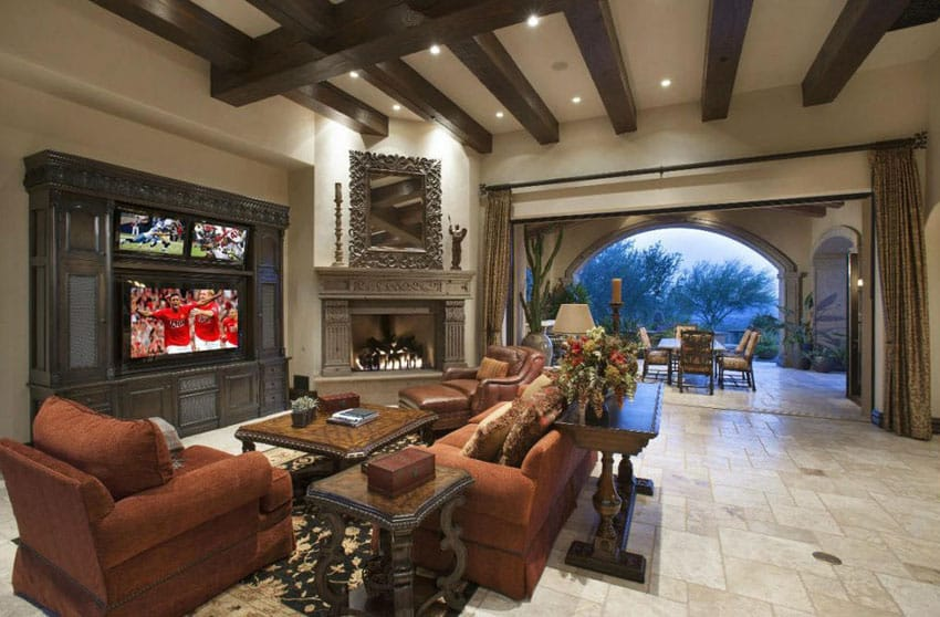 Luxury craftsman living room with arched outdoor view and cement fireplace