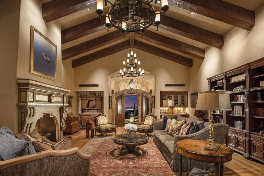 Luxury craftsman living room with elegant furniture and large vaulted beams