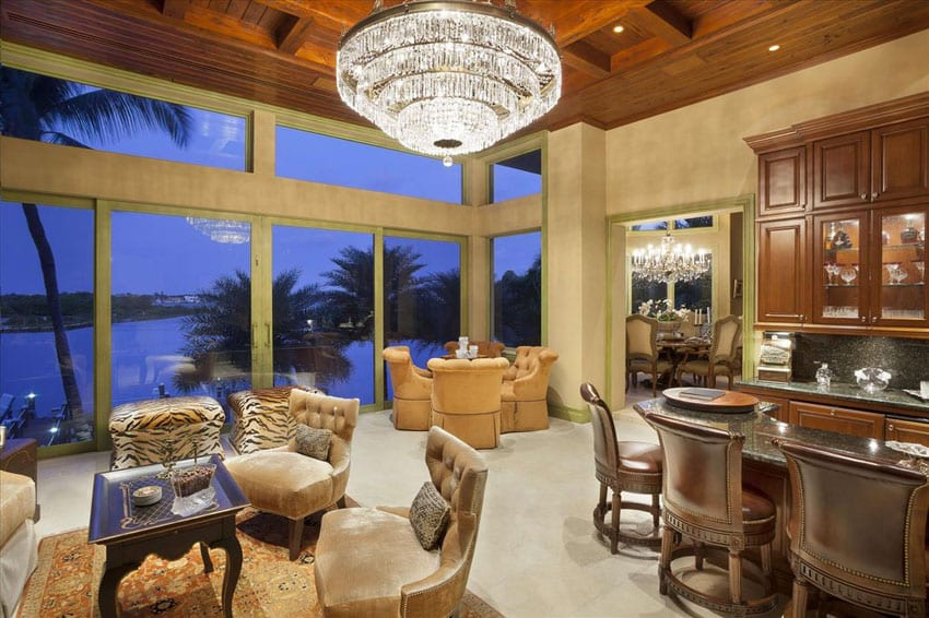 Luxury craftsman living room with view of canal and large crystal chandelier