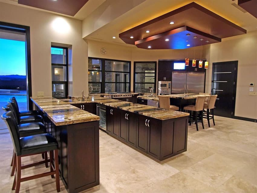 Luxury kitchen with breakfast bar peninsula and travertine flooring