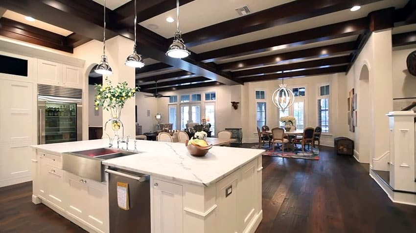 Luxury kitchen with white cabinet island marble counter and dark hardwood floors