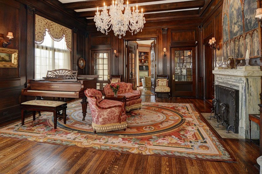 Luxury living room with elegant furnishings decorative fireplace and custom woodwork paneling