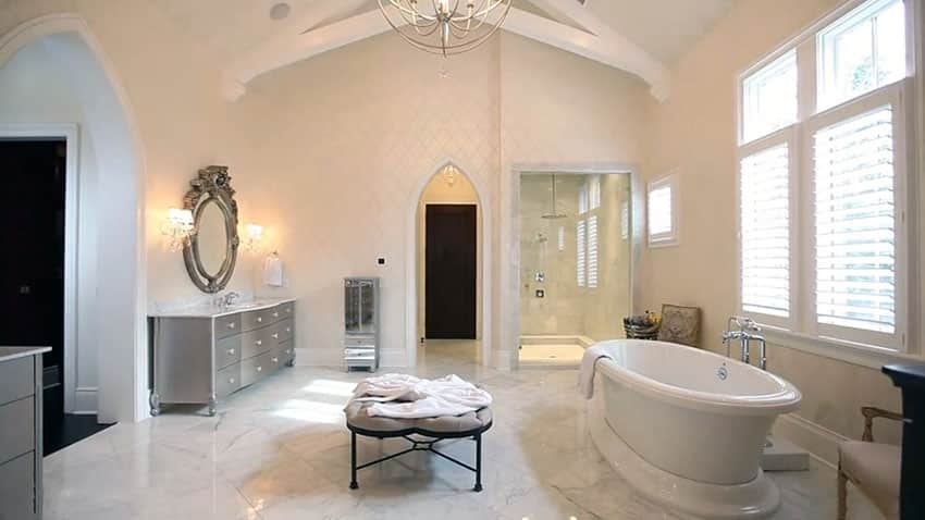 Luxury master bathroom with marble tile and oval bathtub